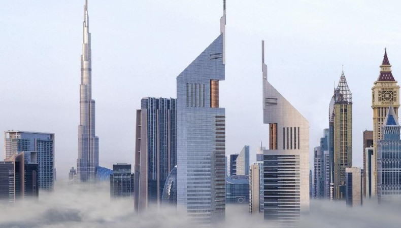 jumeirah-emirates-towers-exterior-clouds-hero